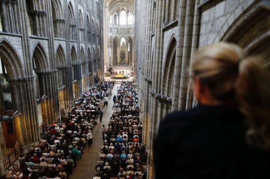 People attend a Mass in tribute to priest Jacques Hamel in the Rouen Cathedral on July 31, 2016. Muslims across France were invited to participate in Catholic ceremonies today to mourn a priest whose murder by jihadist teenagers sparked fears of religious tension. Masses will be celebrated across the country in honour of octogenarian Father Jacques Hamel, whose throat was cut in his church on July 26, 2016 in the latest jihadist attack on France. / AFP / CHARLY TRIBALLEAU (Photo credit should read CHARLY TRIBALLEAU/AFP/Getty Images)