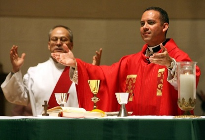 FILE PHOTO OF PRIEST CELEBRATING MASS